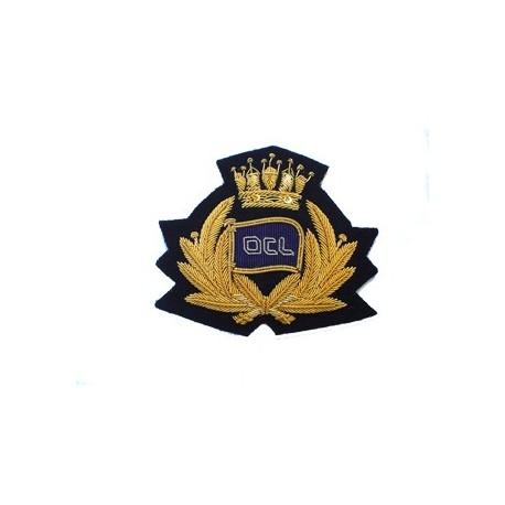 OCL Cap Badge